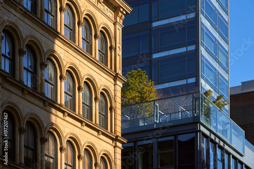 soho building facades with contrasting architectural styles new