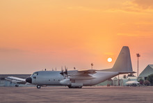 Transport Military Cargo Aircraft Parked Standby Ready To Takeoff For Military Mission On Runway In The Base Airforce On Sunset