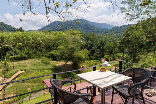 Foto op Plexiglas Toscane Table with chairs in restaurant with mountains view