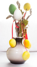 A Vase With Eggs On Twigs Of W...