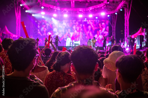 Obraz Stage  concert light. People are watching the concert. - fototapety do salonu