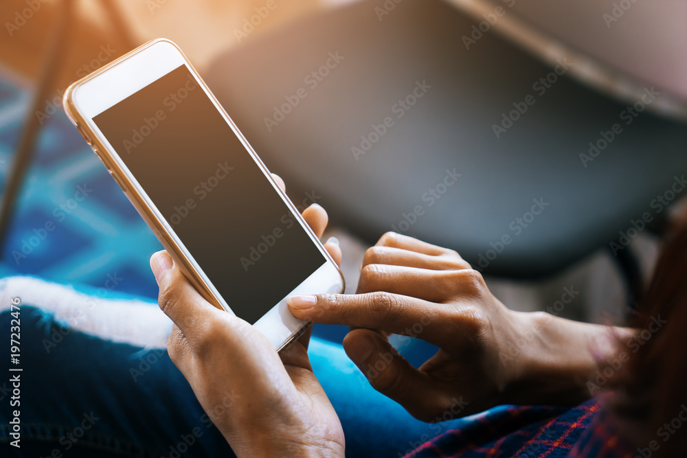 Fototapeta Woman hold and touching blank mobile screen for mock up