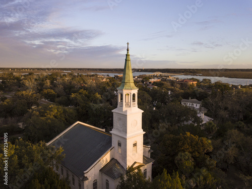 Low aerial view of church steeple in coastal South Carolina, USA.