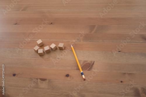 Fotografie, Obraz  Craftsman labels wooden cube with pencil