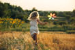 Leinwanddruck Bild - Cute little girl playing in the summer field of wheat
