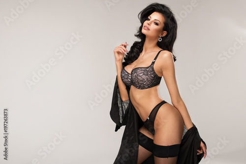 Canvas Print Sexy attractive brunette woman posing in fashionable lingerie in studio