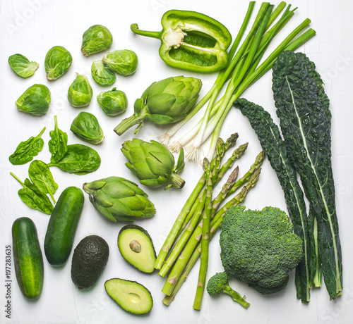 Keuken foto achterwand Groenten Green vegetables and herbs assortment on a white background. Flat lay series of assorted green vegetables. Fresh organic produce. Healthy food. Top view