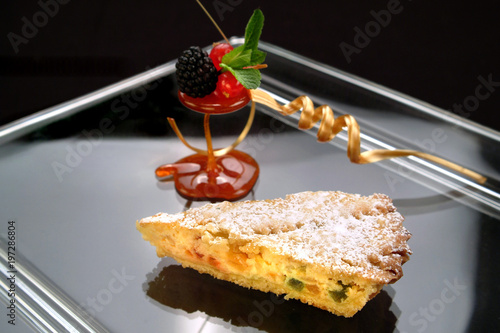 Photo  Italian food recipe, traditional  Neapolitan cake Pastiera with ricotta cheese, cooked wheat and candied fruit