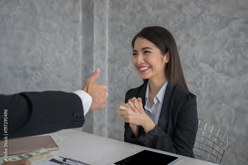 Business people co-workers are looking at each other with smile after success contract accept Wallpaper Mural