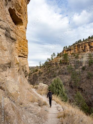 Boy Walking On Trail At Gila Cliff Dwellings National