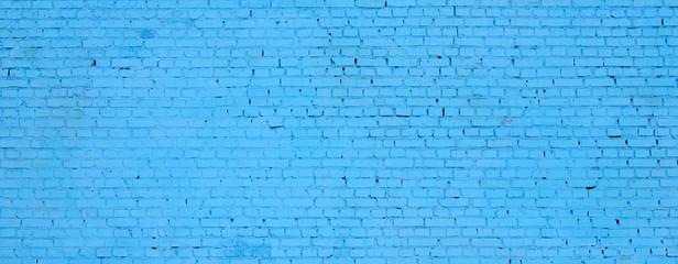 Kwadratowy cegła bloku ściany tło i tekstura. Malowany na niebiesko