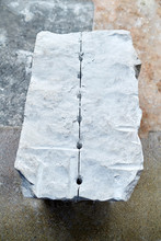 A Marble Slab With Drilled Hol...