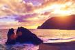 Beautiful seascape. Sandy beach, rocks and sea at sunset