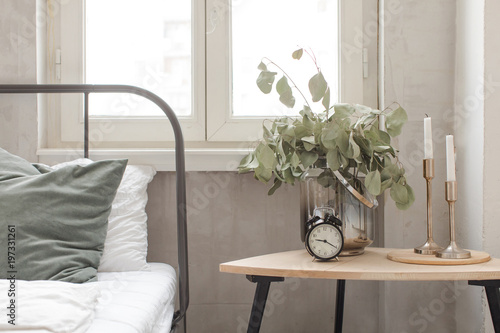Bedroom interior with clock plant pot on wooden table Canvas Print