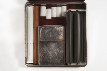 Old Gasoline Lighter Filters Cigarette And Cigarillos Placed In Cigarette-case Close-up Isolated White Background