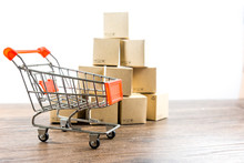 Shopping Cart And Box On Wood Table With White Background  Business Shopping , Concept Online Shopping.