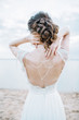canvas print picture - Young pretty woman in elegant dress. Back view bridal fashion background. Monochrome.