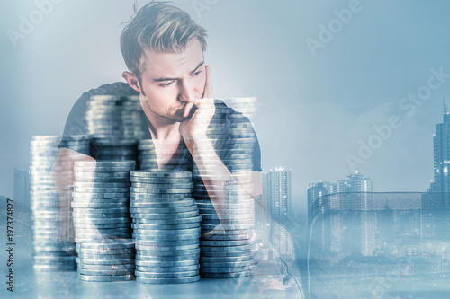 Fotografie, Obraz  white caucasian  black color tshirt stress and thinking with money coin stack do