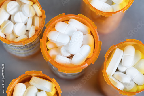 Top view of full prescription bottles on stainless steel background Canvas Print