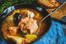 French Fish Soup Bouillabaisse With Seafood, Salmon Fillet, Shrimp, Rich Flavor, Delicious Dinner.