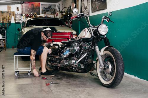 Mechanic repairing the motorcycle