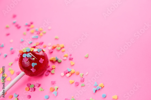 Photographie pink round lollipop close-up on pink background
