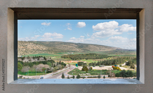 landscape through  window in the wall