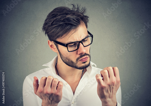 man with obsessive compulsive disorder exploring cleanliness of hands Fototapet