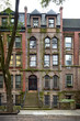 A tall brownstone building in an iconic neighborhood of Manhattan, New York