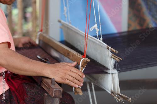 Fotografie, Obraz  Thai silk cotton with worker weaving