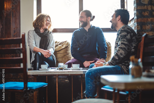 Fényképezés  Group of friends laughing at the coffee shop