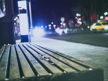 Bus Stop Bench In The City Blurry Background