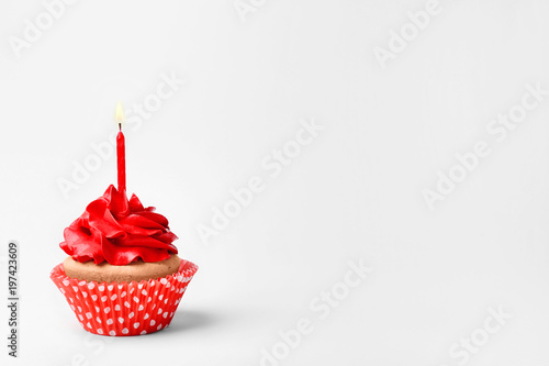 Birthday cupcake with candle on white background Wallpaper Mural