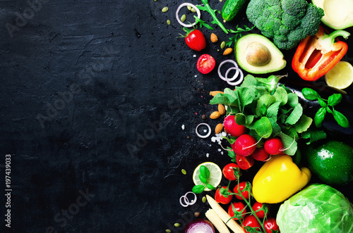 Foto op Canvas Kruiden Set of fresh vegetables on a black background. Aromatic herbs, onion, avocado, broccoli, pepper bell, eggplant, cabbage, radish, cucumber, almonds, rucola, baby corn. Banner