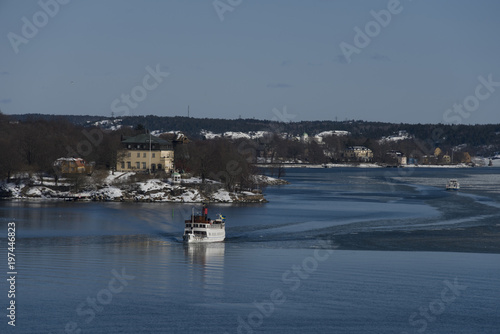 Spoed Foto op Canvas Poort Winter in Stockholm a cold and icy day with landmarks, ships and ferries at the waterfront