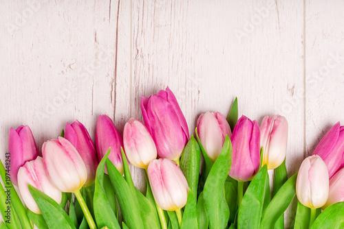 Foto op Plexiglas Tulp Tulips on the white wooden background