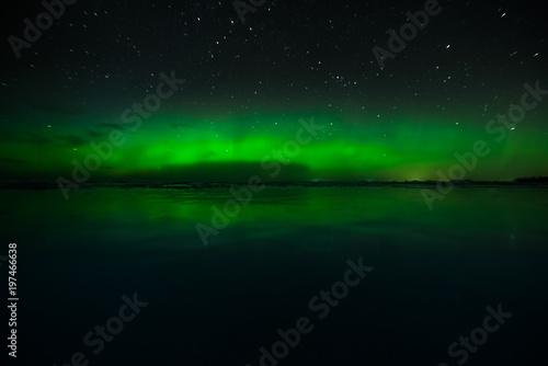 Fotografia, Obraz  Night sky view of beautiful green aurora borealis (northern polar lights) in Fin