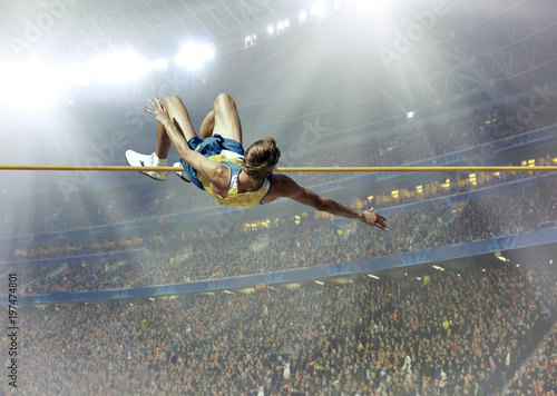 Fotomural  Athlete in action of high jump.