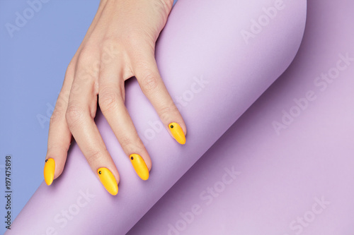Papiers peints Manicure Nails Design. Hands With Bright Yellow Manicure