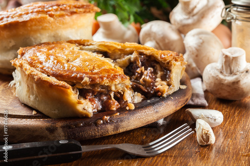Fresh beef stew pie on a cutting board