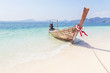 Longtail boat mooring on the tropical beach in the andaman sea krabi Thailand on sunny day