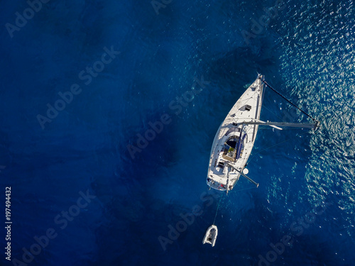 Deurstickers Luchtfoto Aerial view of the white luxury yacht in the exotic turquoise sea.