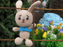 Knitted Toy Easter Bunny On Spring Festive Background