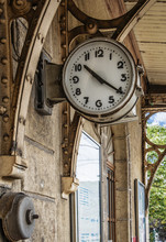 Old Clock Outside On Wall  In Train Station, Grunge Effect