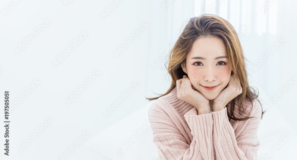 Fototapeta Portrait of young beautiful asian woman relax in her bedroom. Smile happy asian girl isolated on white background banner.