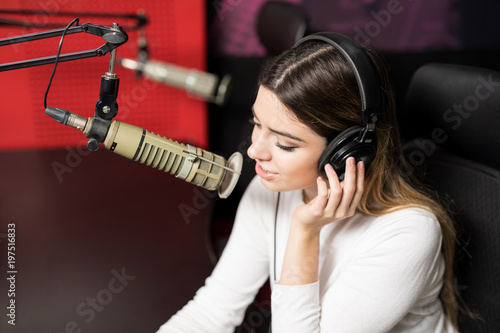 Leinwand Poster Radio announcer broadcasting show in a studio