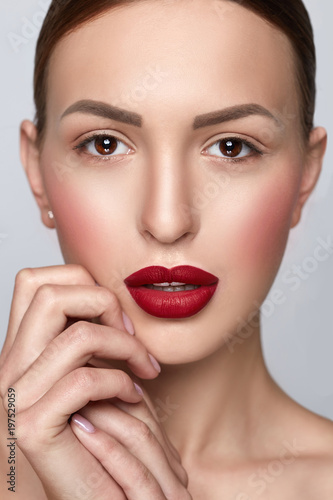 Fototapety, obrazy: Beauty Woman Portrait with clean skin. Professional Makeup for Brunette. Beautiful Fashion Model Girl. Perfect Skin Contouring Make up. Isolated on a Grey Background.