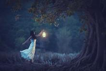 Beautiful Girl In White Holdin...
