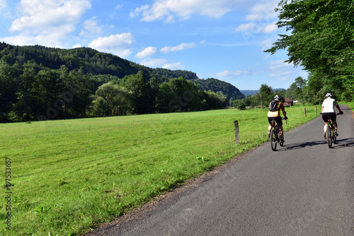 Foto op Canvas Fietsen People ride bicycles between Mala Skala and Turnov at Bohemian Paradise, Czech Republic
