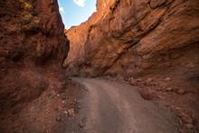 Dangerous Gravel Road Between Mountain Rock In Scenic Desert